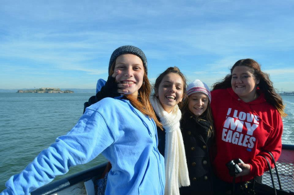 Girls on a boat in San Francisco with Alcatraz