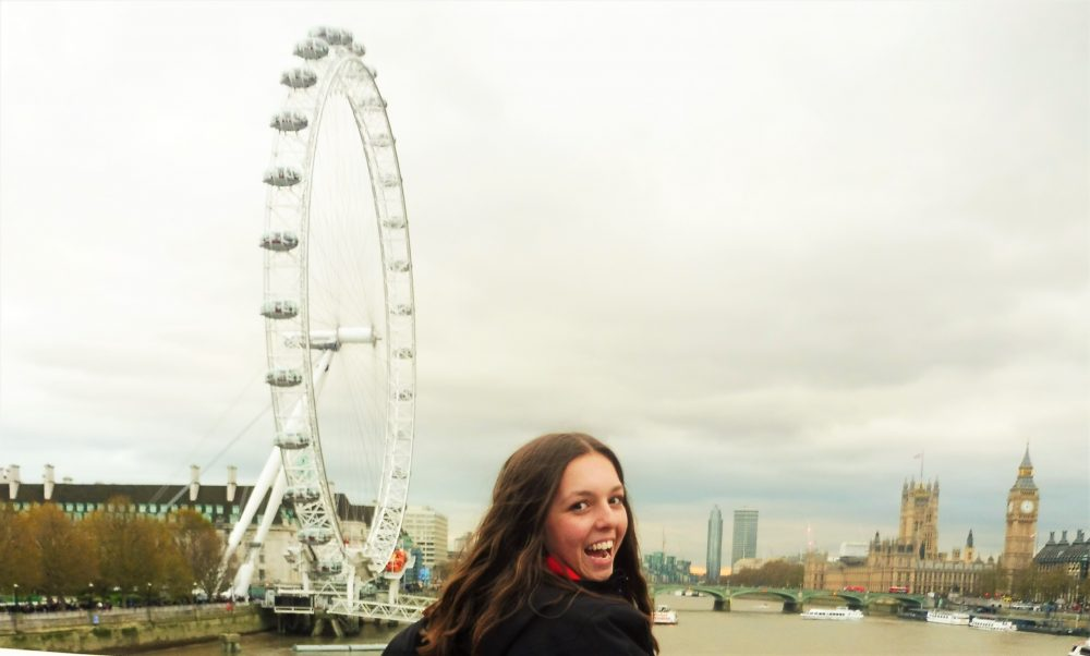 Happy girl with London Eye and Big Ben