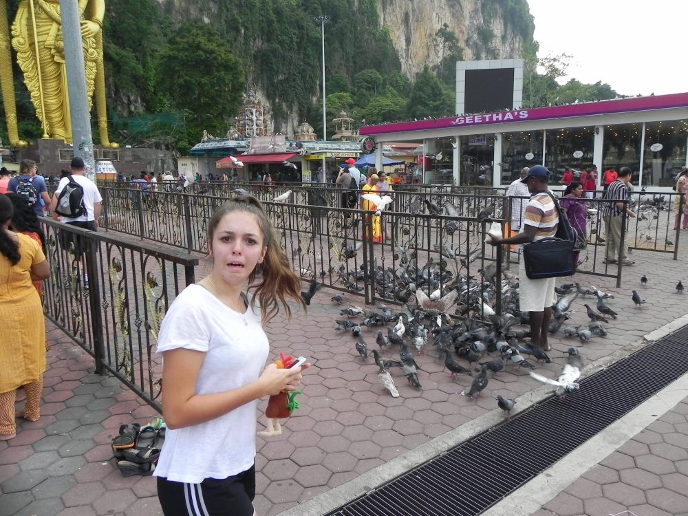 Pigeons and girl at Batu Caves, Malaysia