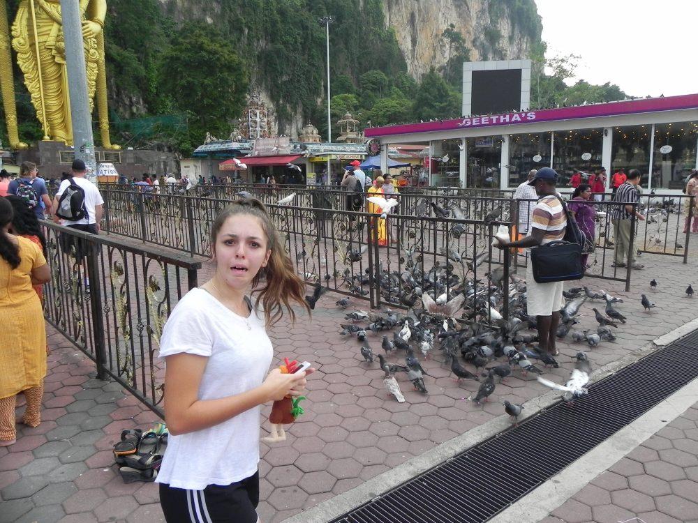 Pigeons and girl at Batu Caves, Malaysia