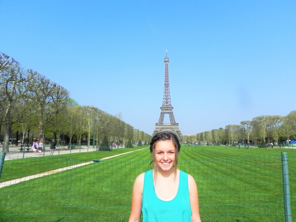 Funny girl with Eiffel Tower Paris