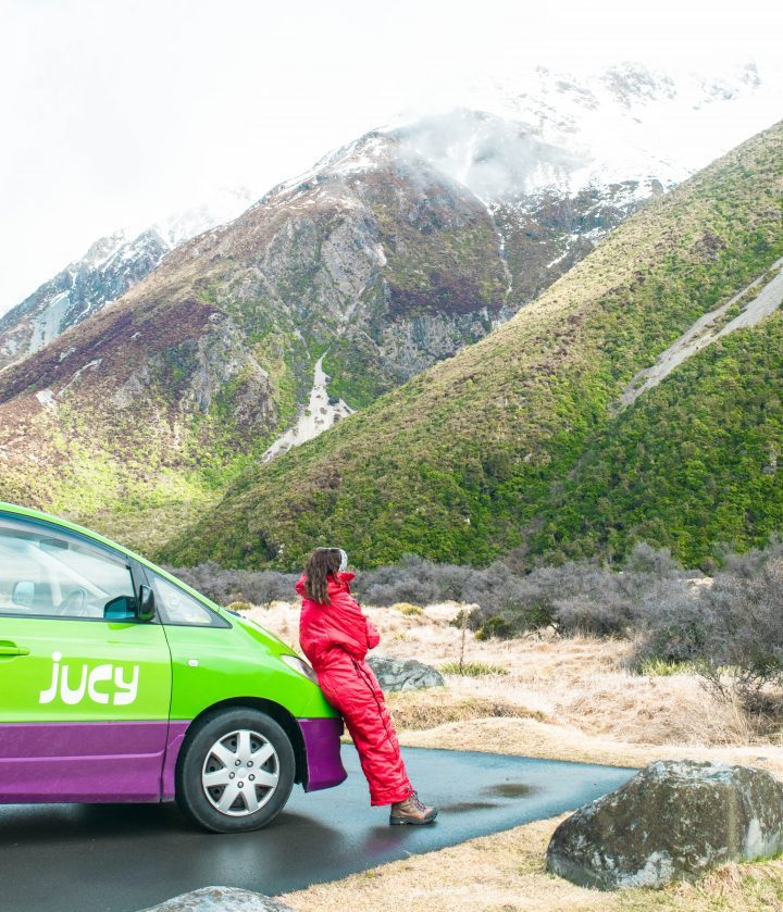 Jucy rentals Tasman Glacier New Zealand girl in Aldi sleeping bag